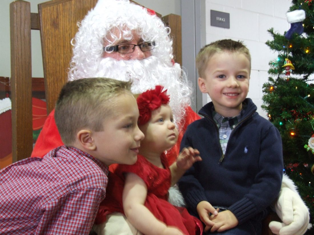 Two children on Santa's lap at a previous Breakfast with Santa event